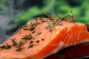 fatty fish, like salmon, can help you achieve healthier cholesterol levels and are high in protein