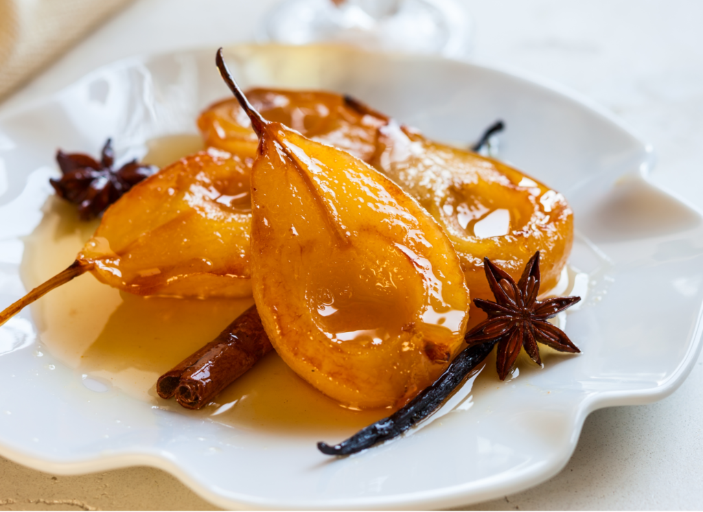 candied pears with cinnamon on white plate