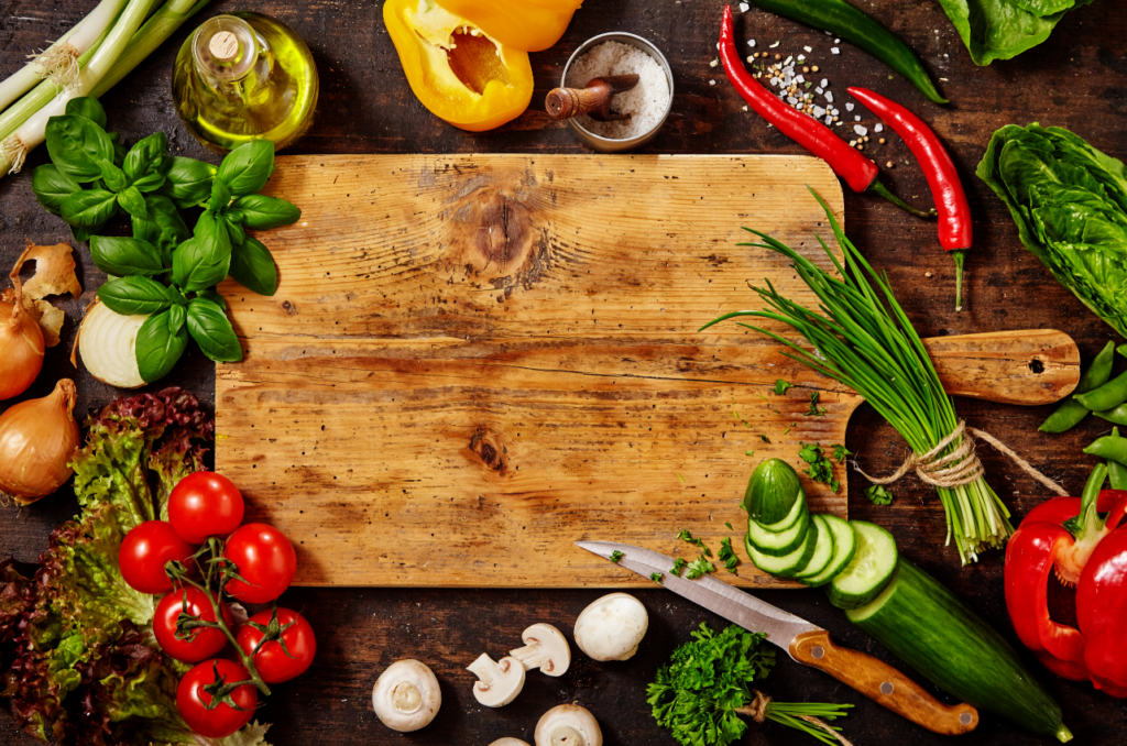 Assortment of Raw Vegetables on Rustic Wood Table