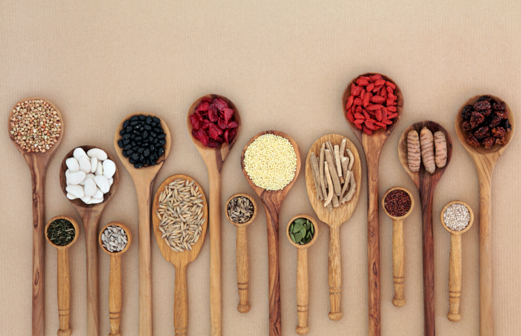 Superfood for good health in wooden spoons forming an abstract background