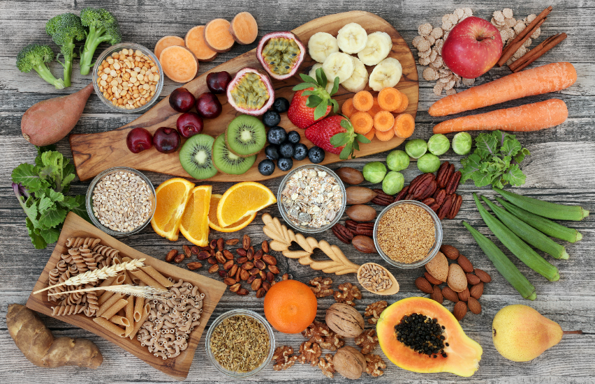 Health food concept for a high fiber diet with fruit, vegetables, cereals, nuts, seeds, whole wheat pasta, grains, legumes and spice